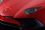Open grilles and detailed headlights on this Rosso Bia Superveloce